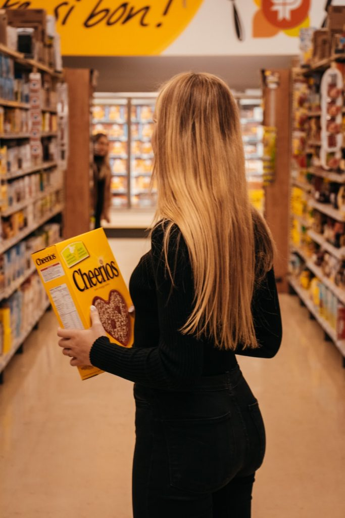 Soccer player checks out different types of cereal, Cheerios pictured here